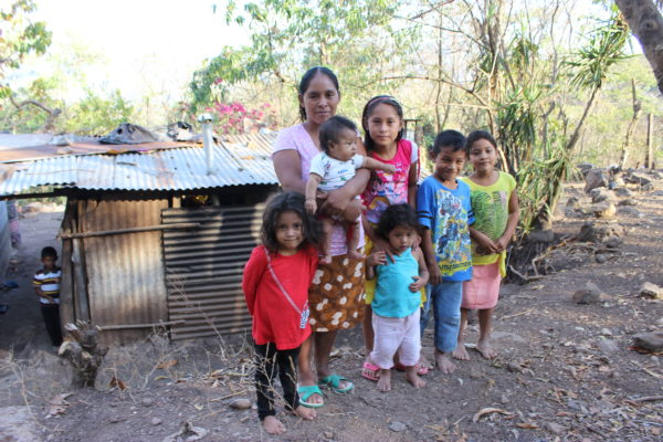 Before: Maria lived in this small shack with her children